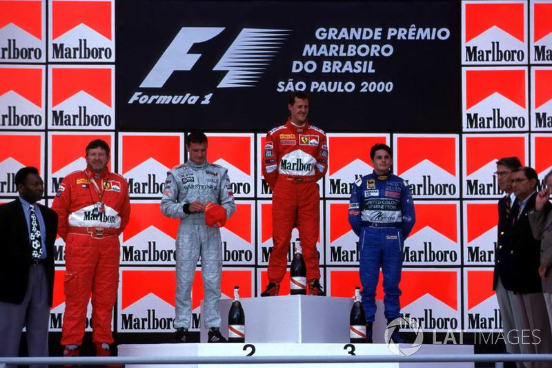 2000. Інтерлагос. Подіум: 1. Міхаель Шумахер, Ferrari. 2. Джанкарло Фізікелла, Benetton Playlife. 3. Хайнц-Харальд Френтцен, Jordan Mugen Honda