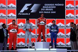 Podium: Race winner Michael Schumacher, Ferrari, second place David Coulthard, McLaren, third place Giancarlo Fisichella, Benetton, with footballer Pele and Ferrari Technical Director Ross Brawn