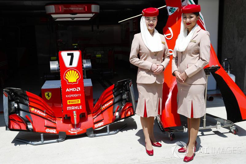 Etihad flight attendants outside the Ferrari garage