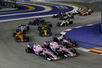 Esteban Ocon, Racing Point Force India VJM11 and Sergio Perez, Racing Point Force India VJM11 battle at the start of the race