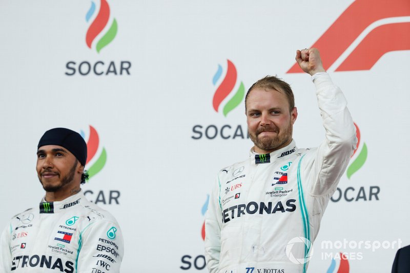 Lewis Hamilton, Mercedes AMG F1, 2nd position, and Valtteri Bottas, Mercedes AMG F1, 1st position, on the podium