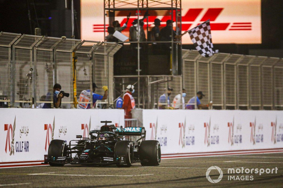 Race winner Lewis Hamilton, Mercedes F1 W11 crosses the finish line