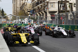 Carlos Sainz Jr., Renault Sport F1 Team R.S. 18, leads Lance Stroll, Williams FW41 Mercedes, Sergio Perez, Force India VJM11 Mercedes, Nico Hulkenberg, Renault Sport F1 Team R.S. 18, Fernando Alonso, McLaren MCL33 Renault, and the remainder of the field at the start