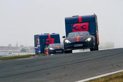 Max Verstappen and Daniel Ricciardo with caravans