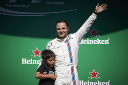 Felipe Massa, Williams, with his son Felipinho waves to his home fans from the podium after his final home race