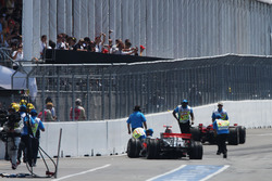 Lewis Hamilton, McLaren Mercedes MP4/23 and Kimi Raikkonen, Ferrari F2008 crash at the end of the pit lane