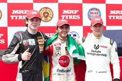 Победитель Пьетро Фиттипальди, серебряный призер Харрисон Ньюи и бронзовый призер Мик Шумахер