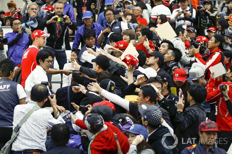 Sebastian Vettel, Ferrari, meets the fans in the grandstand