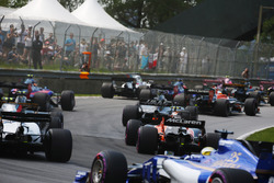 Marcus Ericsson, Sauber C36, brings up the rear of a midfield straggle at the start