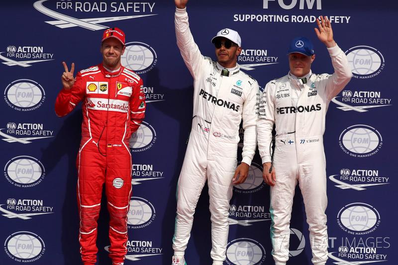 Polesitter Lewis Hamilton, Mercedes AMG F1 celebrates in parc ferme, Sebastian Vettel, Ferrari and Valtteri Bottas, Mercedes AMG F1