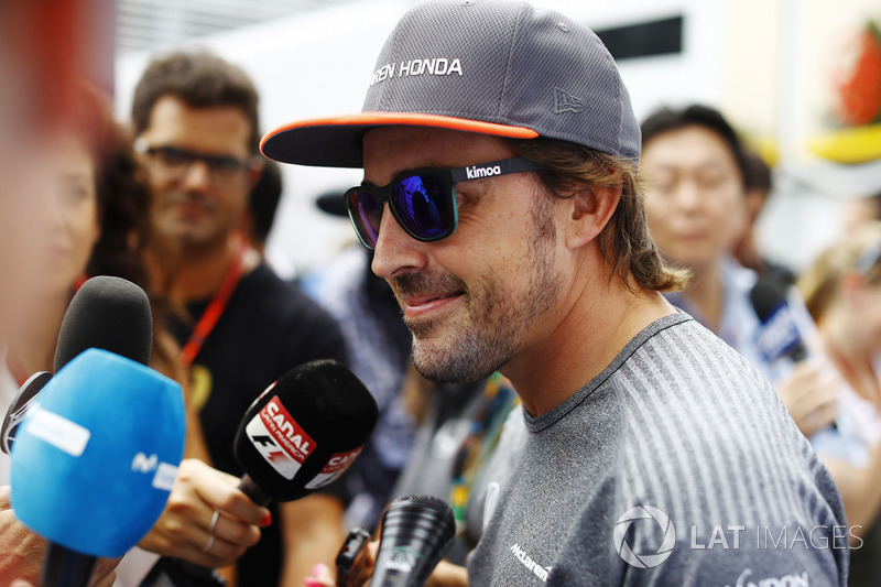 Fernando Alonso, McLaren, speaks to the media