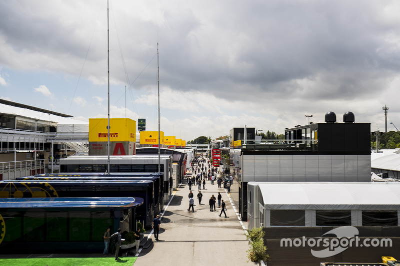 Motorhomes, trucks and hospitality units in a scenic view of the Barcelona paddock. The FIA motorhomes are in the foreground