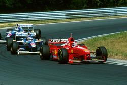 Michael Schumacher, Ferrari F310B leads Jacques Villneuve, Williams