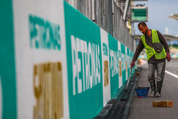 Track worker paints Petronas branding