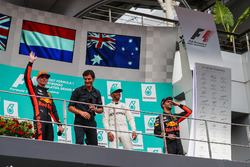 Race winner Max Verstappen, Red Bull Racing celebrates on the podium, Mark Webber, Lewis Hamilton, Mercedes AMG F1 and Daniel Ricciardo, Red Bull Racing