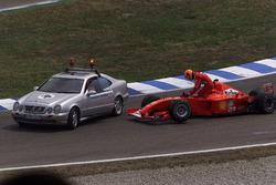 Michael Schumacher, Ferrari F2001, climbs out of his wrecked car
