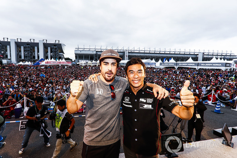 Takuma Sato on stage with Fernando Alonso, McLaren