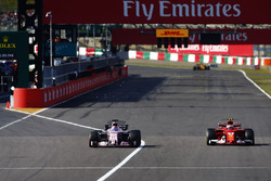 Kimi Raikkonen, Ferrari SF70H, battles with Sergio Perez, Sahara Force India F1 VJM10