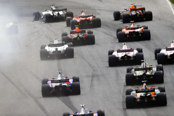 Debris kicks up as Lewis Hamilton, Mercedes AMG F1 W08, the field through a corner
