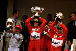 Podium: Race winner Michael Schumacher, Ferrari F310B; second place Rubens Barrichello, Stewart SF1 Ford; third place Eddie Irvine, Ferrari F310B