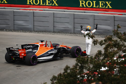 Fernando Alonso, McLaren, waves to the crowd after encountering technical trouble in FP1