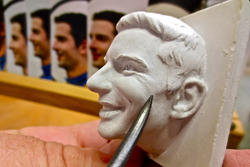 Sculptor William Behrends adds finer details to the ceramic likeness of 2016 Indianapolis 500 winner