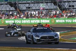 The Safety Car leads Valtteri Bottas, Mercedes AMG F1 W09, and Sebastian Vettel, Ferrari SF71H