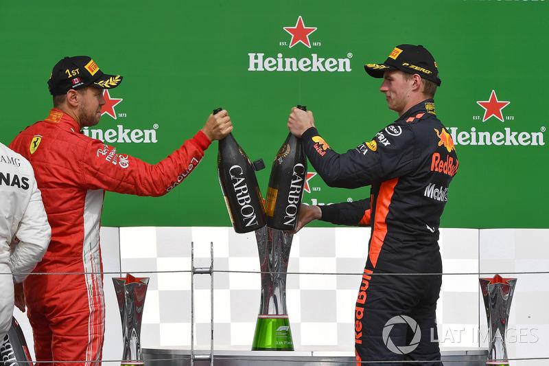 Sebastian Vettel, Ferrari and Max Verstappen, Red Bull Racing celebrate on the podium with the champ
