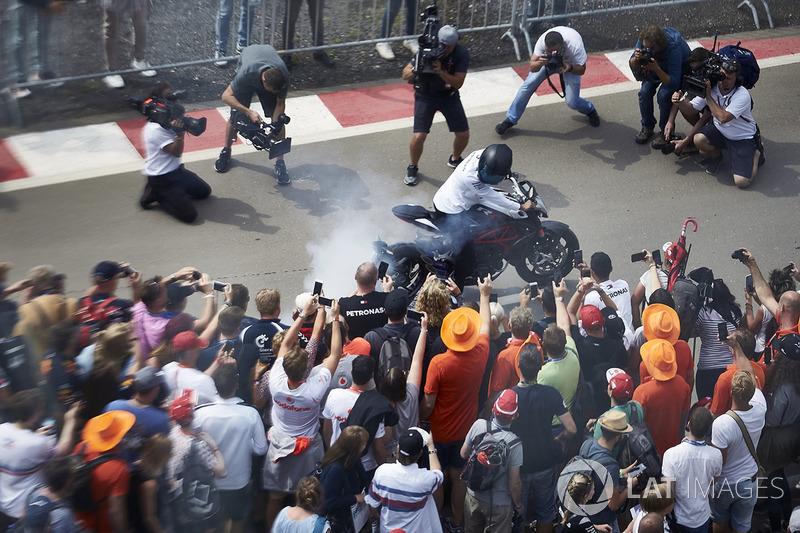 Lewis Hamilton, Mercedes AMG F1, on his motorbike