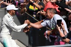Lewis Hamilton, Mercedes AMG F1 celebrates on the podium with the fans