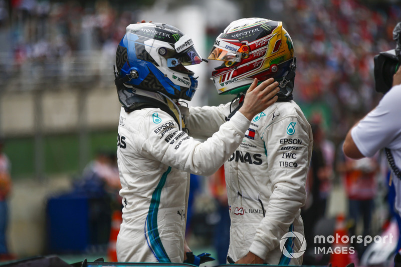 Lewis Hamilton, Mercedes AMG F1, celebrates victory in parc ferme, with Valtteri Bottas, Mercedes AMG F1.