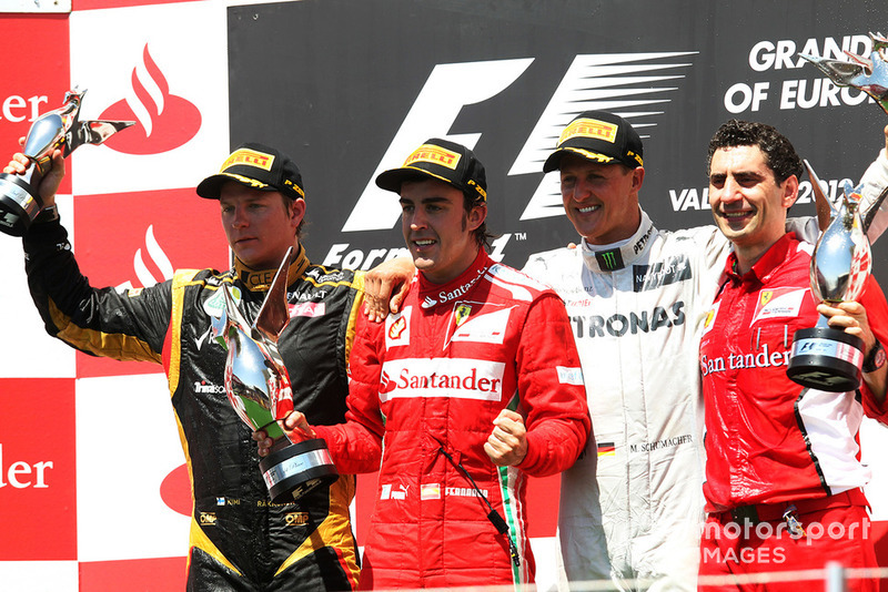 Kimi Raikkonen, Lotus F1, Fernando Alonso, Ferrari, Michael Schumacher, Mercedes AMG F1 and Andrea Stella, Ferrari Race Engineer celebrates on the podium