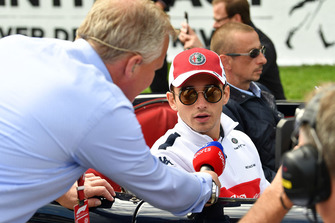 Charles Leclerc, Sauber talks with Johnny Herbert, Sky TV on the drivers parade