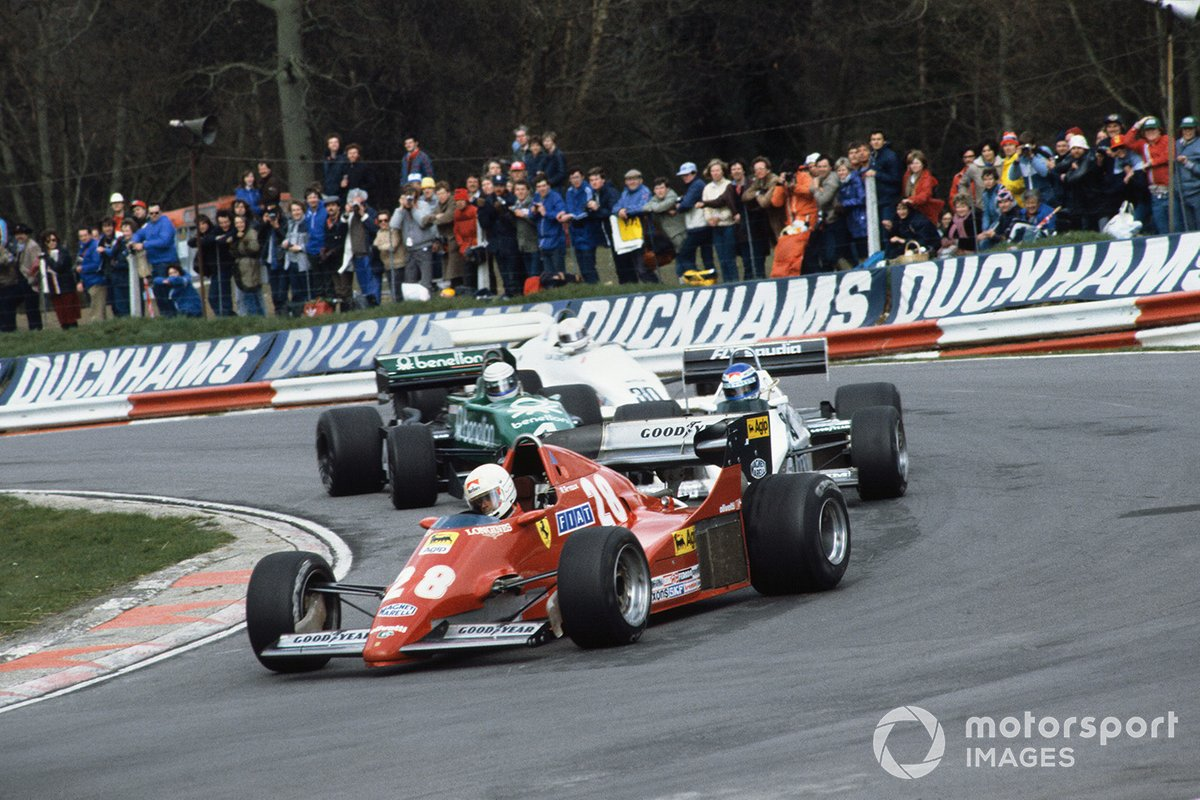 Rene Arnoux, Ferrari 126C2B, leads Keke Rosberg, Williams FW08C-Cosworth, Danny Sullivan, Tyrrell 011-Cosworth and Alan Jones, Arrows A6-Cosworth