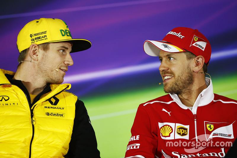 Nico Hülkenberg, Renault Sport F1 Team; Sebastian Vettel, Ferrari