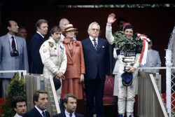 Podium: Race winner Riccardo Patrese, Brabham BT49D-Ford Cosworth, third place (later fifth place) Elio de Angelis, Lotus 91-Ford Cosworth, Princess Grace and Prince Rainier