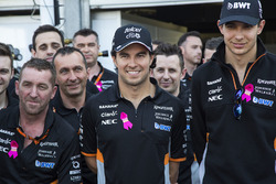 Sergio Perez, Force India, Esteban Ocon, Force India F1 and the team mechanics at the reveal of the the Breast Cancer Care partnership with Force India F1