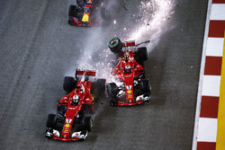 Kimi Raikkonen, Ferrari SF70H hits Sebastian Vettel, Ferrari SF70H and Max Verstappen, Red Bull Racing RB13
