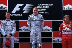 Podium: race winner Mika Hakkinen, McLaren, second place David Coulthard, McLaren, third place Ruben