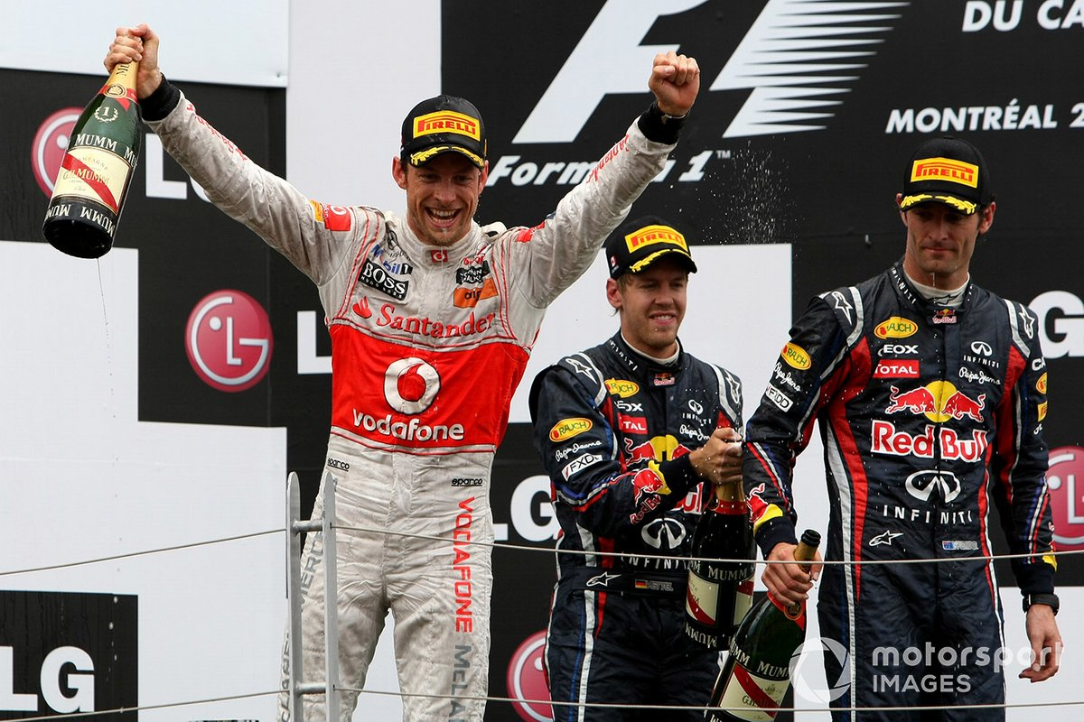 Podium: race winner Jenson Button, McLaren MP4-26 Mercedes, 2nd position Sebastian Vettel, Red Bull Racing RB7 Renault and 3rd position Mark Webber, Red Bull Racing RB7 Renault, celebrate on the podium
