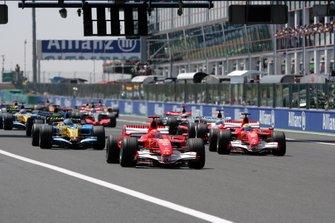 Michael Schumacher, Ferrari 248 F1 leads the start