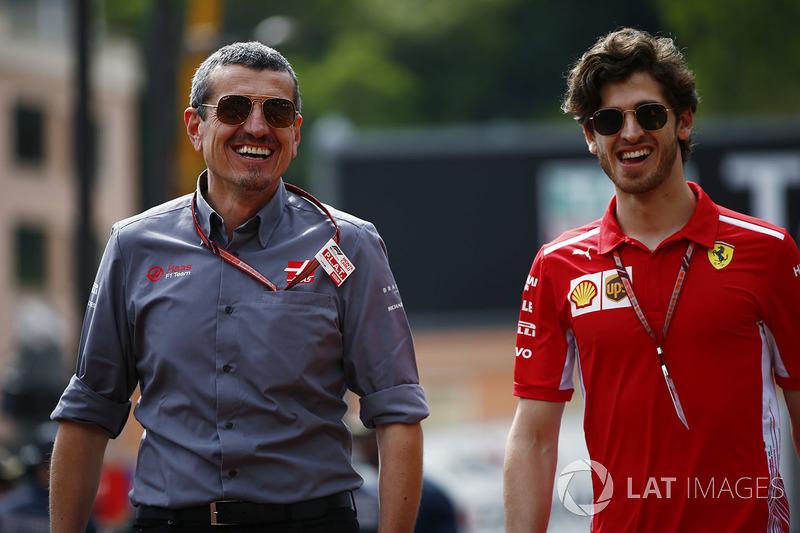 Guenther Steiner, Team Principal, Haas F1, and Antonio Giovinazzi, Ferrari development driver