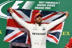 Race winner Lewis Hamilton, Mercedes AMG F1 celebrates on the podium with the Union flag
