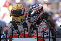 Second place Fernando Alonso, McLaren MP4-22, congratulates third place Lewis Hamilton, McLaren MP4-22