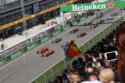 Sebastian Vettel, Ferrari SF71H leads Kimi Raikkonen, Ferrari SF71H at the start of the race