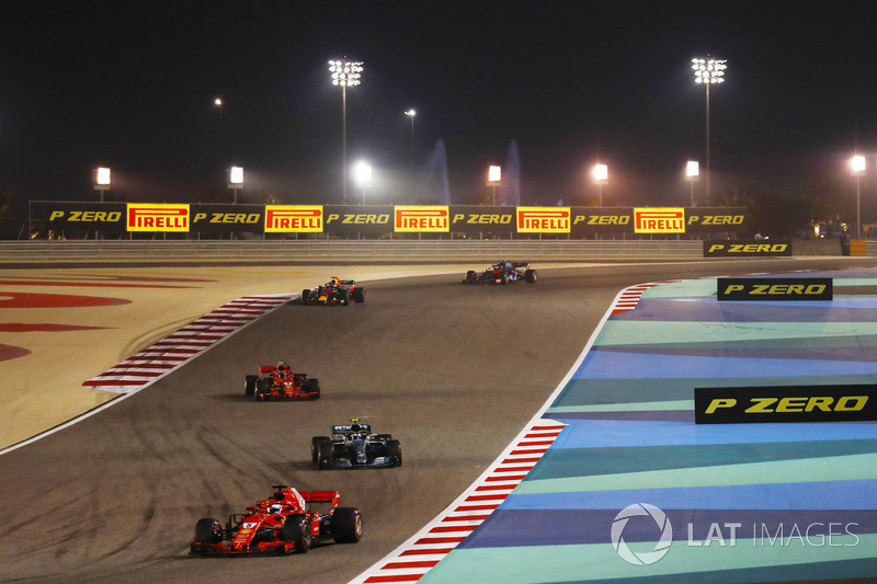 Sebastian Vettel, Ferrari SF71H, leads Valtteri Bottas, Mercedes AMG F1 W09, Kimi Raikkonen, Ferrari SF71H, and Daniel Ricciardo, Red Bull Racing RB14 Tag Heuer, and the rest of the field