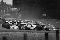 Ronnie Peterson, March 761 Ford, tucked in behind Carlos Reutemann, Ferrari 312T2 and Patrick Depailler Tyrrell P34-Ford at the start of the race
