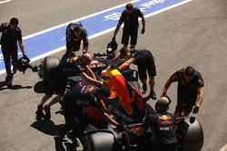 Daniel Ricciardo, Red Bull Racing RB13, is returned to his garage