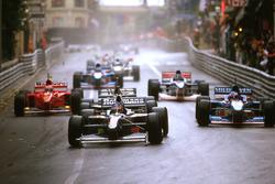 Jacques Villeneuve, Williams FW19 Renault, followed by Jean Alesi, Benetton and Mika Hakkinen, McLaren and Eddie Irvine, Ferrari