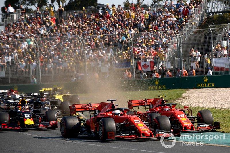 Sebastian Vettel, Ferrari SF90, leads Charles Leclerc, Ferrari SF90 and the rest of the field at the start